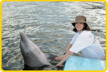 Alberto gives a member of our family a handshake during his swim with the dolphin program.