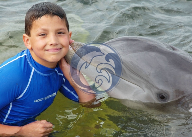 Boy getting a Dolphin Kiss