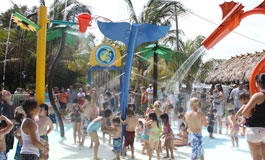 The Sprayground with children playing in water play equipment